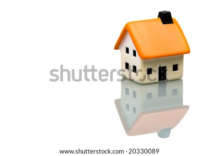 An isolated small house on white background - stock photo
