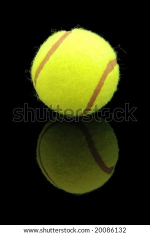 An isolated to black image of a tennis ball with reflection