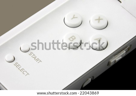 An isolated to black photo of a Portable Games Console Controls - stock photo