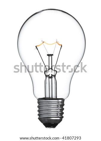An isolated tungsten light bulb turned on. - stock photo