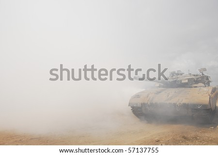 An Israeli tank doing maneuver in open fields and urban area, this is part of regular army training in Israel for regular and reserve soldiers. - stock photo
