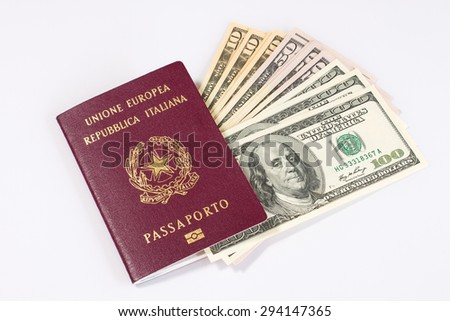 An italian passport and a bunch of dollars banknotes inside it