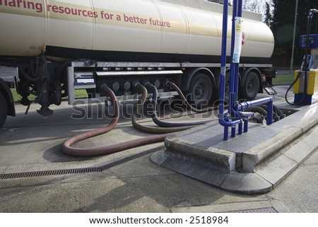 An lorry refueling a petrol station - stock photo
