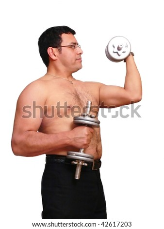 An muscles man is exercising with his dumbbells to stay in shape.