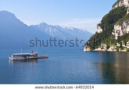 An nice antique Paddle Wheel Boat on Lake Garda (Lago di Garda) Italy. - stock photo