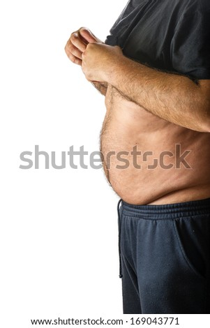An obese man  measuring his belly fat - stock photo