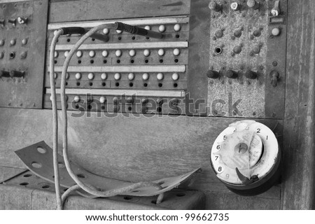 An obsolete vintage wooden telephone central PBX - stock photo