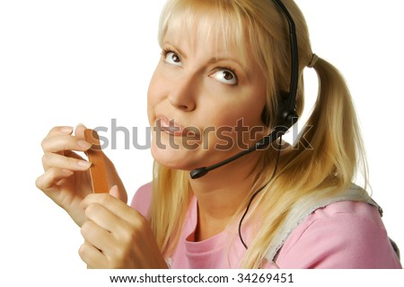 An obviously bored customer support girl waiting for the clock to hit 5:00. - stock photo