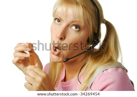 An obviously bored customer support girl waiting for the clock to hit 5:00 - stock photo