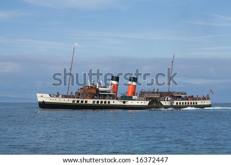 An ocean-going paddle steamer on the Firth of Clyde - stock photo