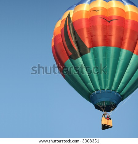 An Ocean Themed Hot Air Balloon in a Clear Blue Morning Sky - stock photo