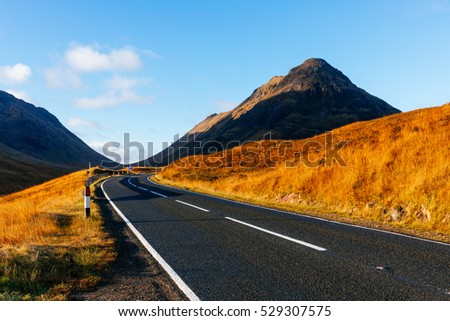 An October early morning light on a road in Highlands, not far from Glencoe, Scotland, UK