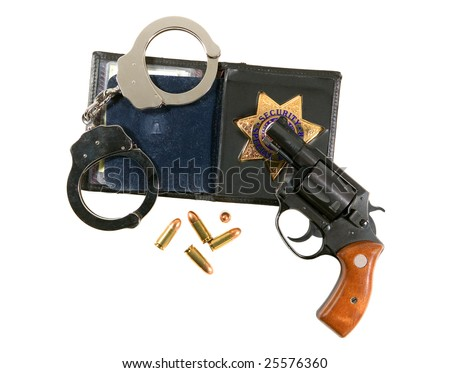 An off-duty police handgun, badge and chrome handcuffs - stock photo