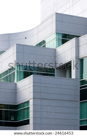 An office building with a empty parking lot - stock photo