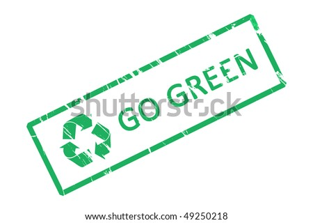 An office stamp with green letters go green. - stock photo