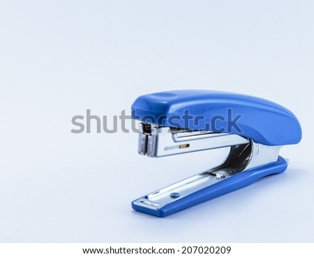 an office stapler with blue hand grip isolated on white background - stock photo