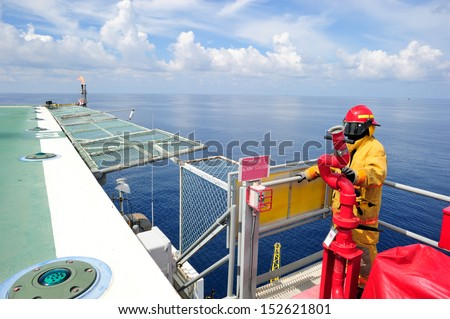 An offshore fireguard on the helideck - stock photo