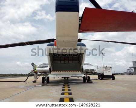 An offshore helicopter is refueling to be ready for the next flight. - stock photo