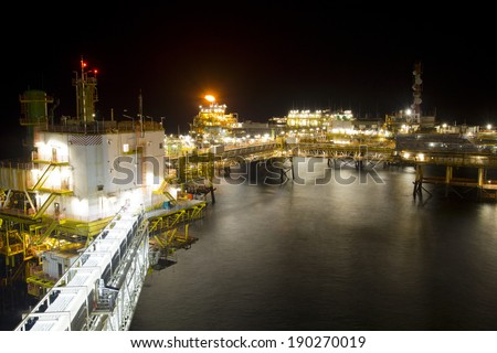 An offshore oil-platform at night - stock photo