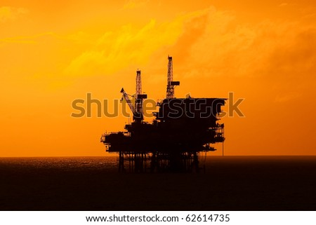 An offshore oil platform at sunset light.  Coast of Brazil, circa 2010.