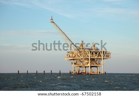 An offshore oil rig off the coast of louisiana. - stock photo