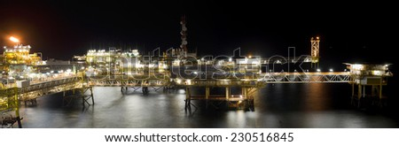 An offshore platform at night - stock photo