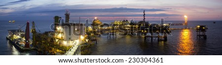 An offshore platform at sunset - stock photo