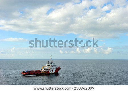 An offshore supply boat transporting people between platform - stock photo
