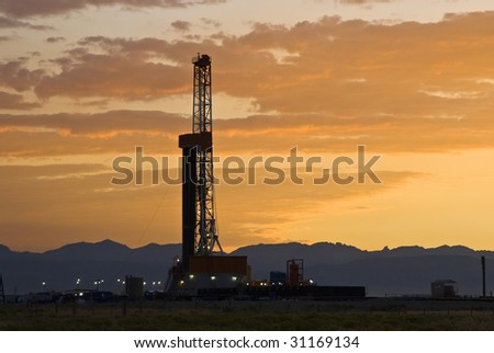 an oil drilling rig in the oil fields of Wyoming - stock photo