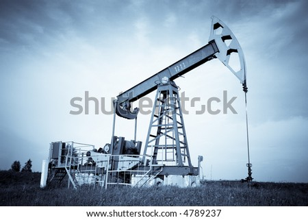An oil pump jack. Selenium tone. - stock photo