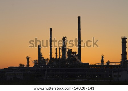 An oil refinery in Gdansk illuminated sunset