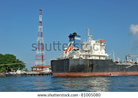 An Oil Tanker At An Offshore Oil Refinery - stock photo