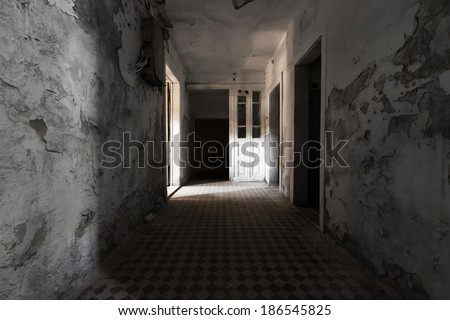 an old abandoned building empty dark corridor in the basement