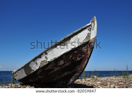 An old abandoned fishing boat at the coast of the island Oeland, Sweden - stock photo