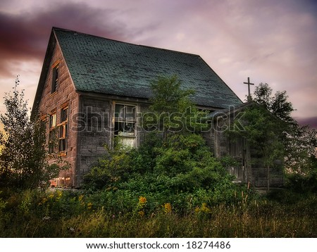 An old abandoned school at sunset - stock photo