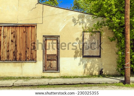 An old abandoned store in the small town of Krydor, Saskatchewan, Canada. - stock photo
