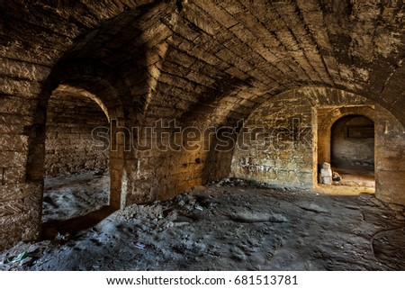 An old abandoned tunnel in an underground wine cellar. Entrance to catacombs. Dungeon An & Old Abandoned Tunnel Underground Wine Cellar Stock Photo u0026 Image ...