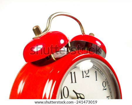 an old alarm clock old red - stock photo