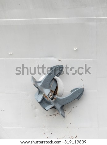 An old anchor (close-up shot) laterally at the ship - stock photo