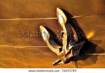 An old anchor on an old ship - stock photo