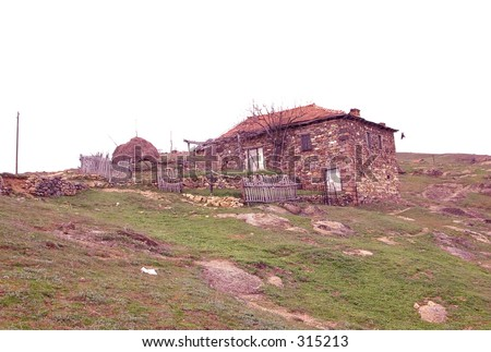 An old and abandoned house in a village in Macedonia - stock photo