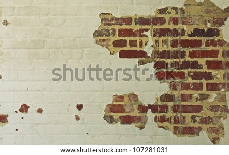 An old and chipping brick wall - stock photo