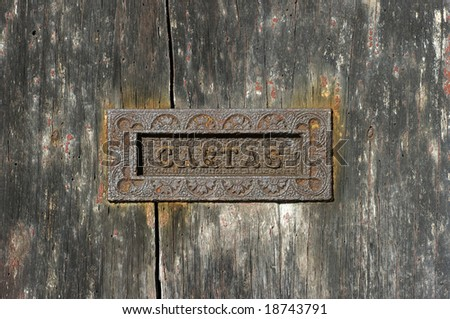 An old and rusty letter box.Portuguese/Brazilian or Spanish written. - stock photo