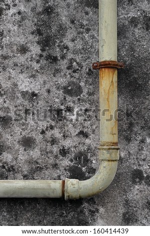 An old and rusty water pipe. - stock photo