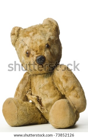 an old and shabby vintage teddy bear on white - stock photo