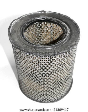 An old and used engine air filter over white background.Shallow DOF - stock photo