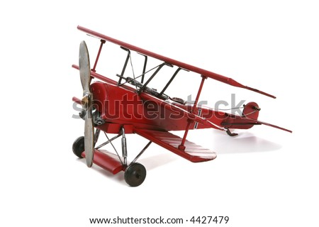 An old antique model airplane over a white background - stock photo