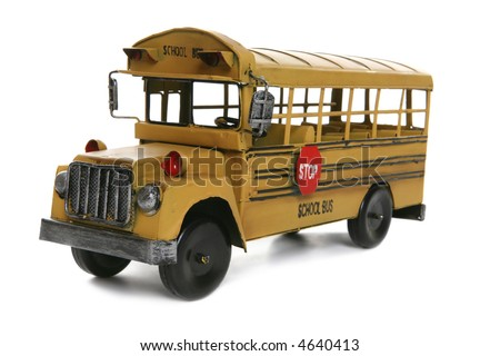 An old antique school bus over a white background - stock photo