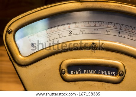 An old antique weigh scale - stock photo