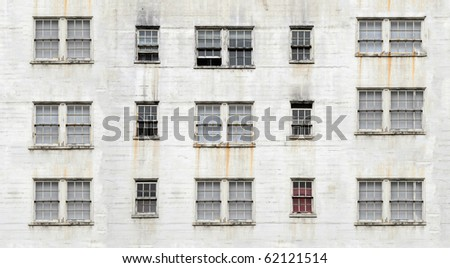 An old apartment building with direct perspective - stock photo